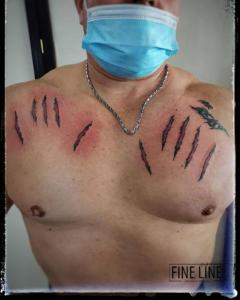 Clawed effect tattoo