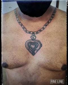 Chain and locket tattoo