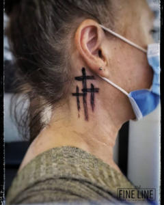Crosses on neck tattoo