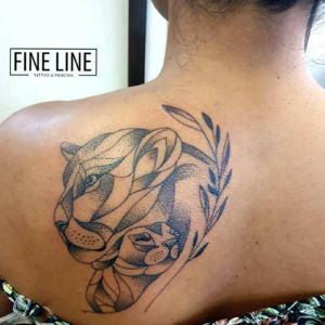 Geometric lion cub tattoo