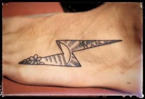 Sunrays in lightning bolt tattoo