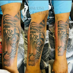 Half tiger tattoo