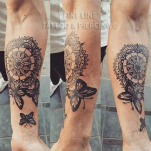Mandala and butterfly tattoo