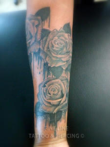 Dripping roses tattoo