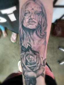 Black and grey lady with rose tattoo