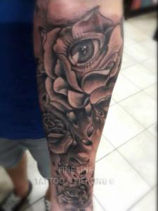 Eye in rose tattoo