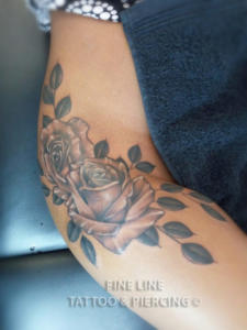 Roses and leaves tattoo