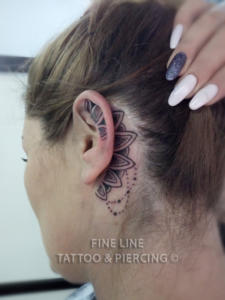 Mandala-inspired ear tattoo