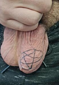 Pentagram on scrotum tattoo.