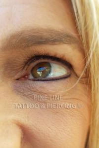 Eye liner tattoo