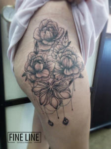 Flowers on hip tattoo