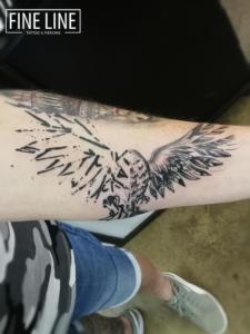 Bird in flight tattoo