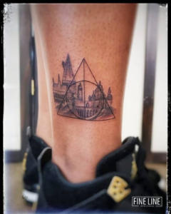 Geometric touch on cityscape tattoo