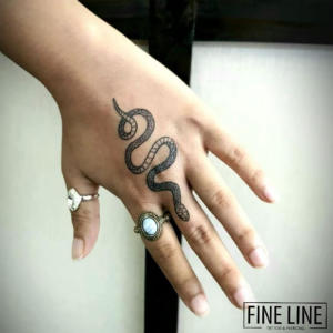 Snake on hand tattoo