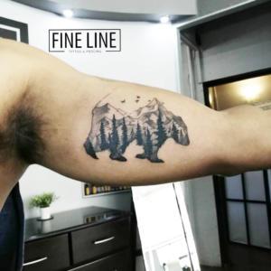 Mountain scenery in bear tattoo