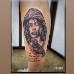 Black crow and lady-face tattoo