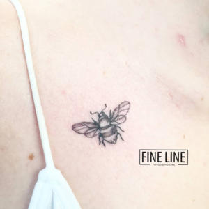 Tiny bee tattoo