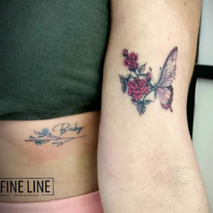 Butterfly and roses morph tattoo